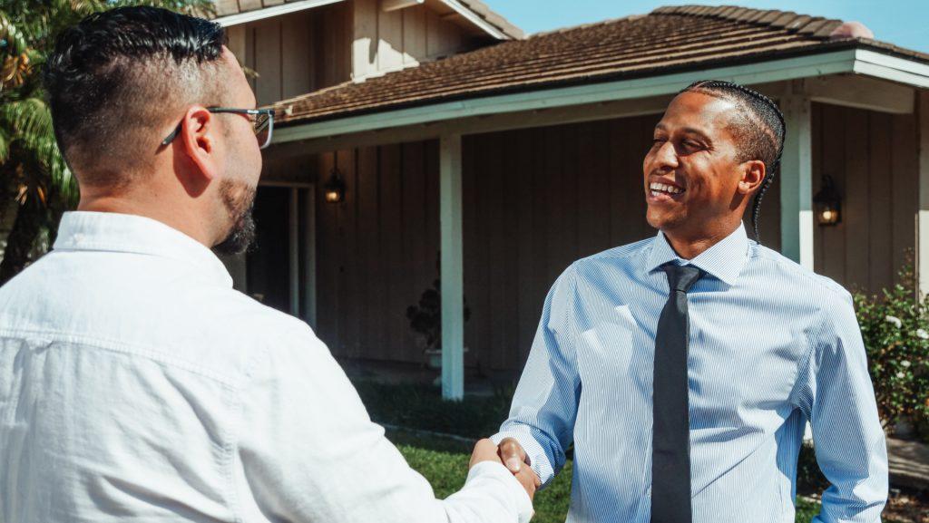 Both men shake hands for agreement